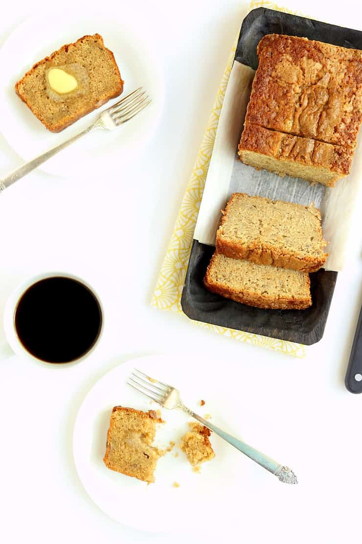 overhead view of sliced banana bread on plates with coffee