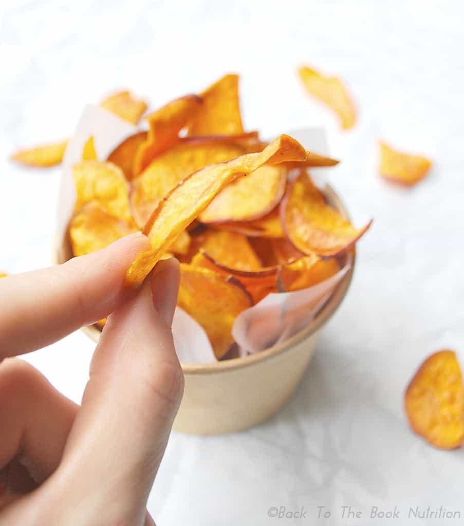 Easy Homemade Sweet Potato Chips holding one