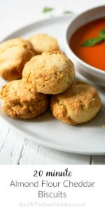almond flour cheddar biscuits on plate with bowl of tomato soup