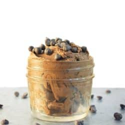 front view of DIY double chocolate body butter in small glass with mini chocolate chips sprinkled on top