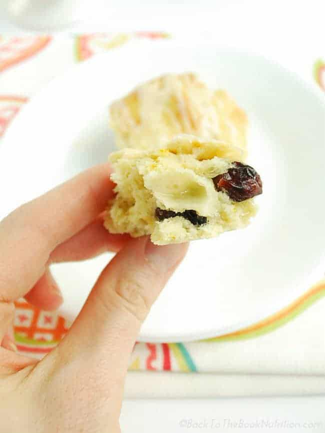 Light and fluffy cranberry scones with pockets of gooey brie and a sweet orange glaze - an irresistible treat for your next holiday breakfast or brunch! | Back To The Book Nutrition