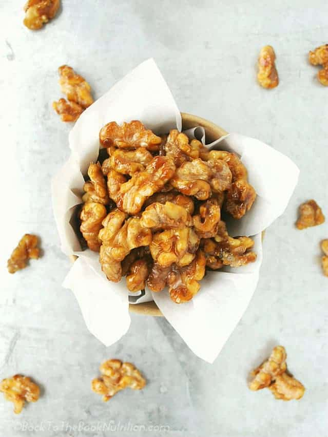 Naturally sweetened candied walnuts made with just 4 ingredients and ready in only 10 minutes! | Back To The Book Nutrition