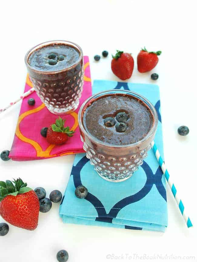Fight colds and flu naturally with this supercharged immune booster green smoothie made with spinach, frozen strawberries, blueberries, raspberries, cherries, and my homemade elderberry syrup! | Back To The Book Nutrition