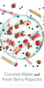 overhead shot of coconut water and fresh berry popsicles in tray