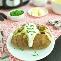 Fully loaded baked potatoes in the slow cooker, then stuffed with butter, cheese, bacon, sour cream, and chives | Back To The Book Nutrition