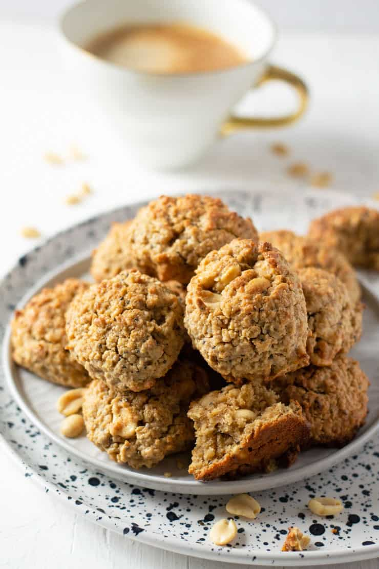 A white plate with a pile of peanut butter oatmeal breakfast cookies