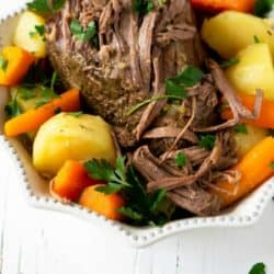 overhead shot of slow cooker beef roast with carrots and potatoes