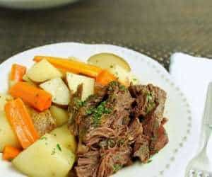 This easy slow cooker beef roast with potatoes and carrots is a family favorite! Made with just a few real food ingredients you already have on hand - no packets of soup mix or canned broth. | Back To The Book Nutrition
