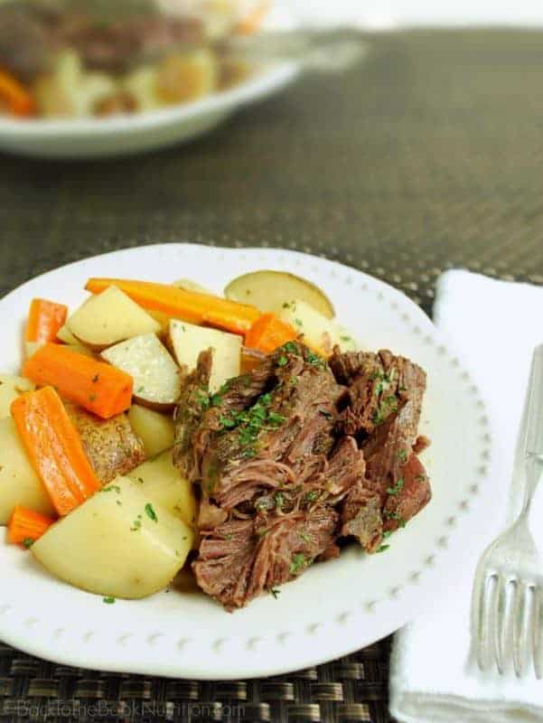 This easy slow cooker beef roast with potatoes and carrots is a family favorite! Made with just a few real food ingredients you may already have on hand - no gravy packets or soup mixes. | Back To The Book Nutrition