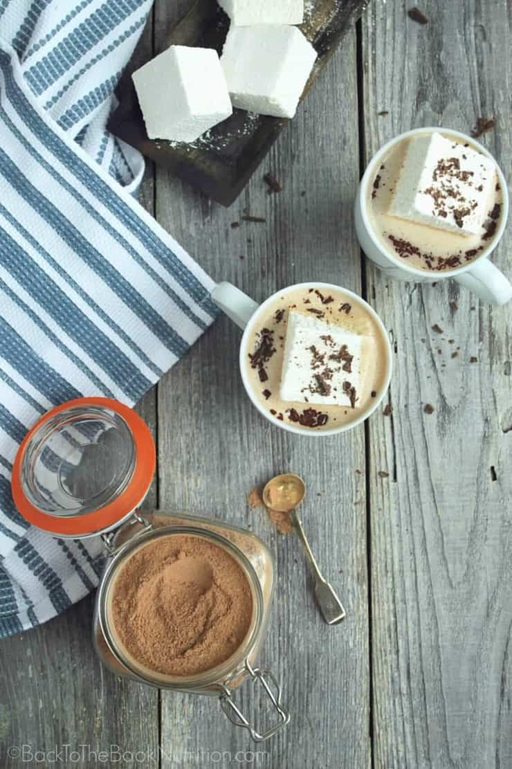 Cozy up with a mug of Healthy Homemade Hot Chocolate - mix is dairy free, naturally sweetened, and comes together in just a few minutes! | Back To The Book Nutrition