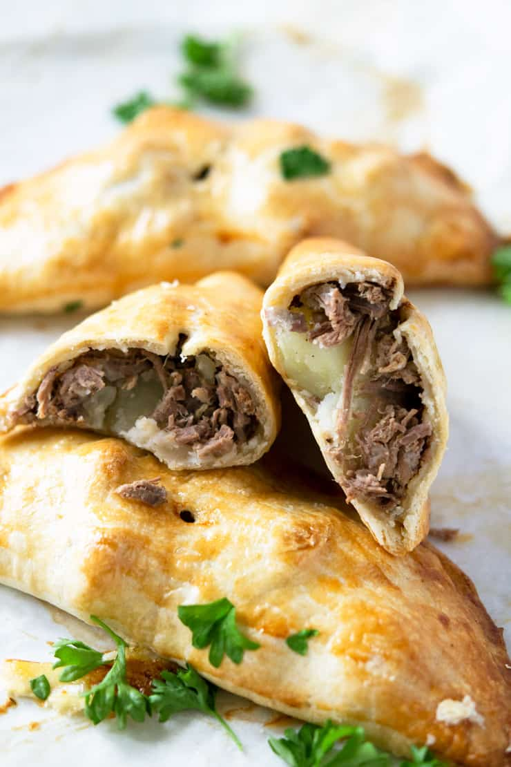 Beef and potato hand pies cut in half