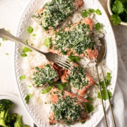 An overhead shot of baked salmon with parmesan crust on a serving plate