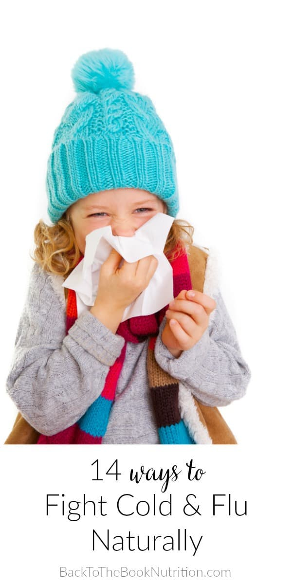 young girl bundled in winter clothing blowing nose