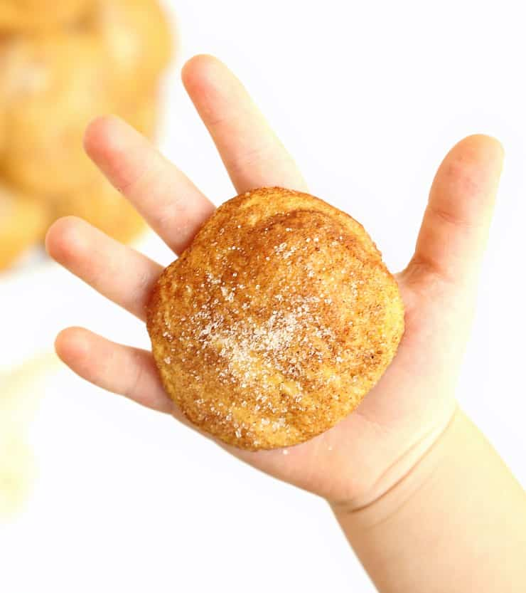 large pumpkin snickerdoodle cookie in child's hand