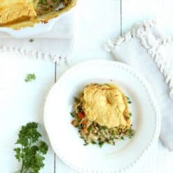 Rustic turkey pot pie in dish with a single serving on plate