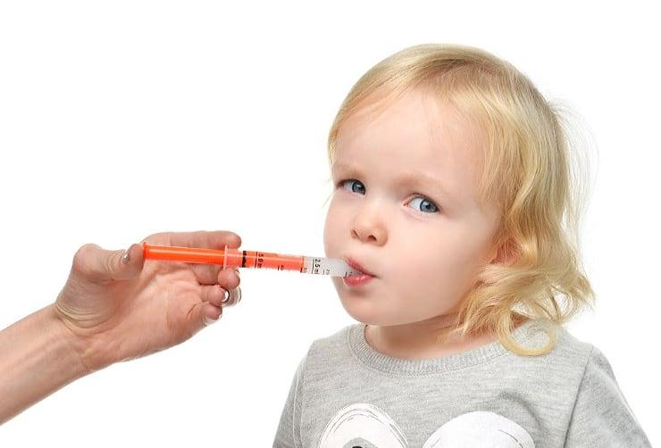 picture of toddler taking antibiotics