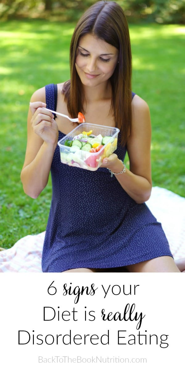 image of woman eating salad on picnic blanket overlayed with article title: 6 signs your diet is really disordered eating