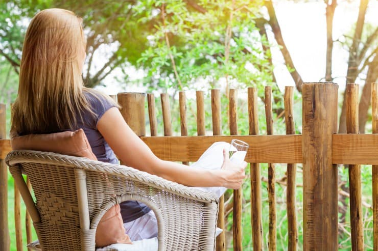 Woman relaxing on back porch