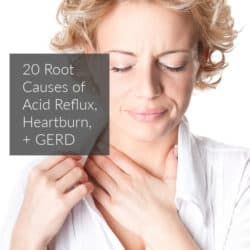 Blonde woman holding her chest in acid reflux pain, text overlay: 20 Root Causes of Acid Reflux, Heartburn, and GERD