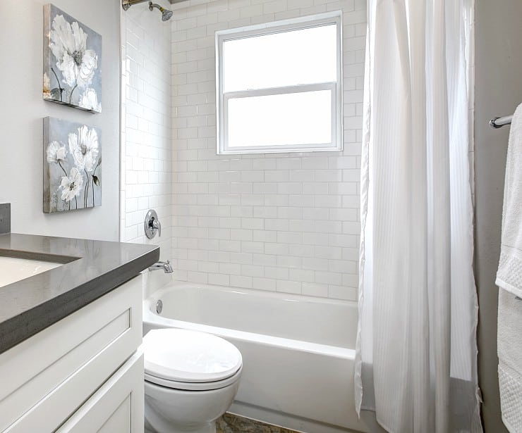 Image of bathroom with white tile and gray accents