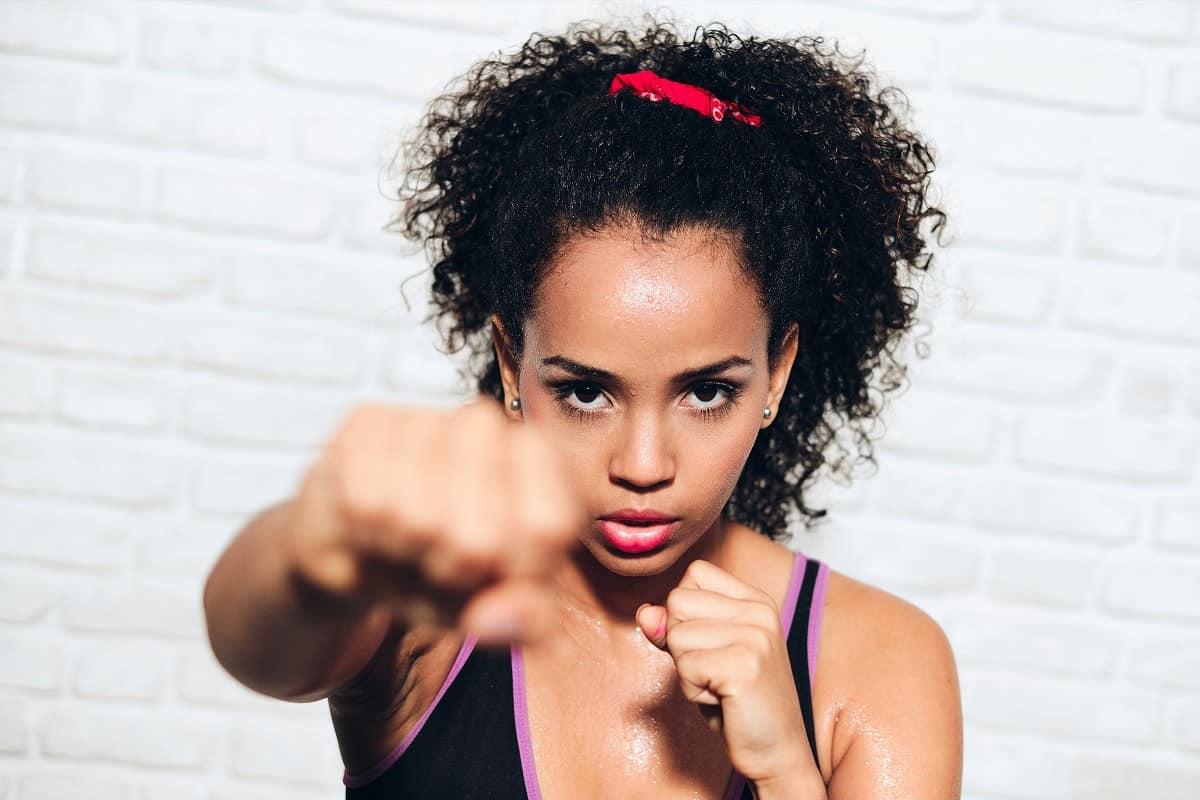 Black woman doing kickboxing workout